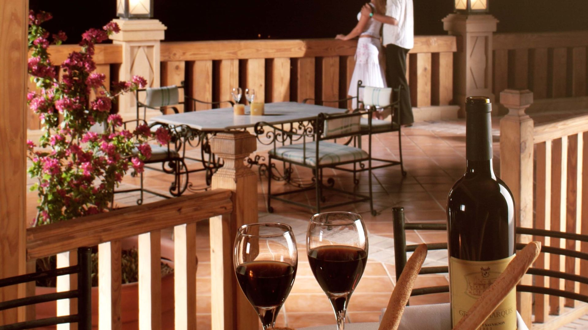 A Dining Table With A Glass Of Wine